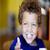 Boy with blue eyes eating yogurt